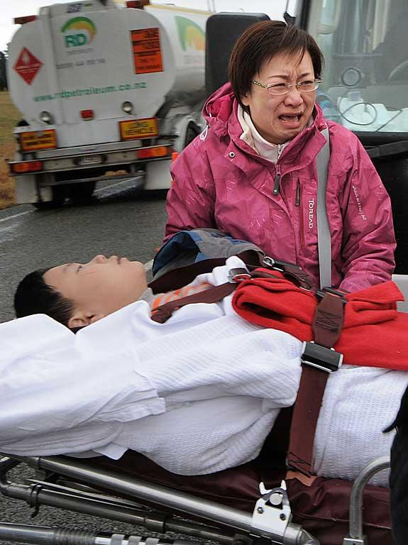 A distraught mother with her injured 9-year-old child.