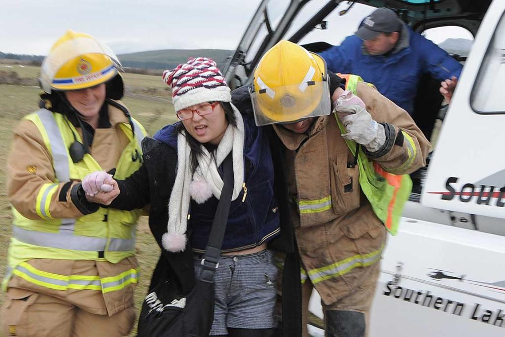 An injured woman about to be moved to a helicopter.