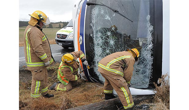 CRASH: Police said the World Away tourist bus had been involved in a crash and landed on its side at about 9am.
