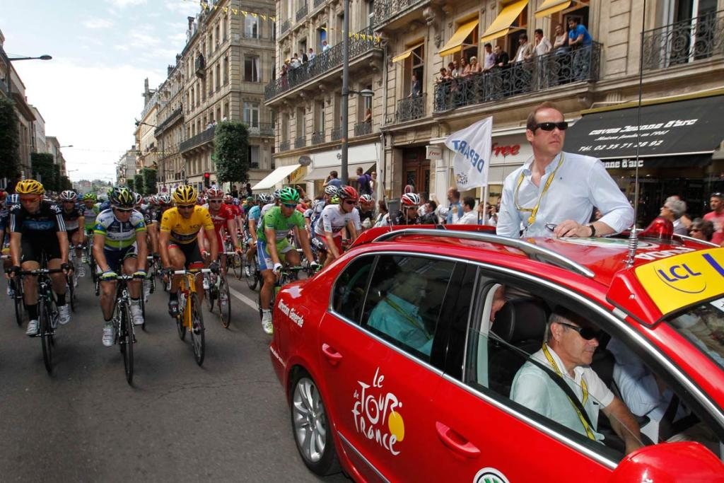 Tour de France director Christian Prudhomme signals the start of the fifth stage in Rouen.