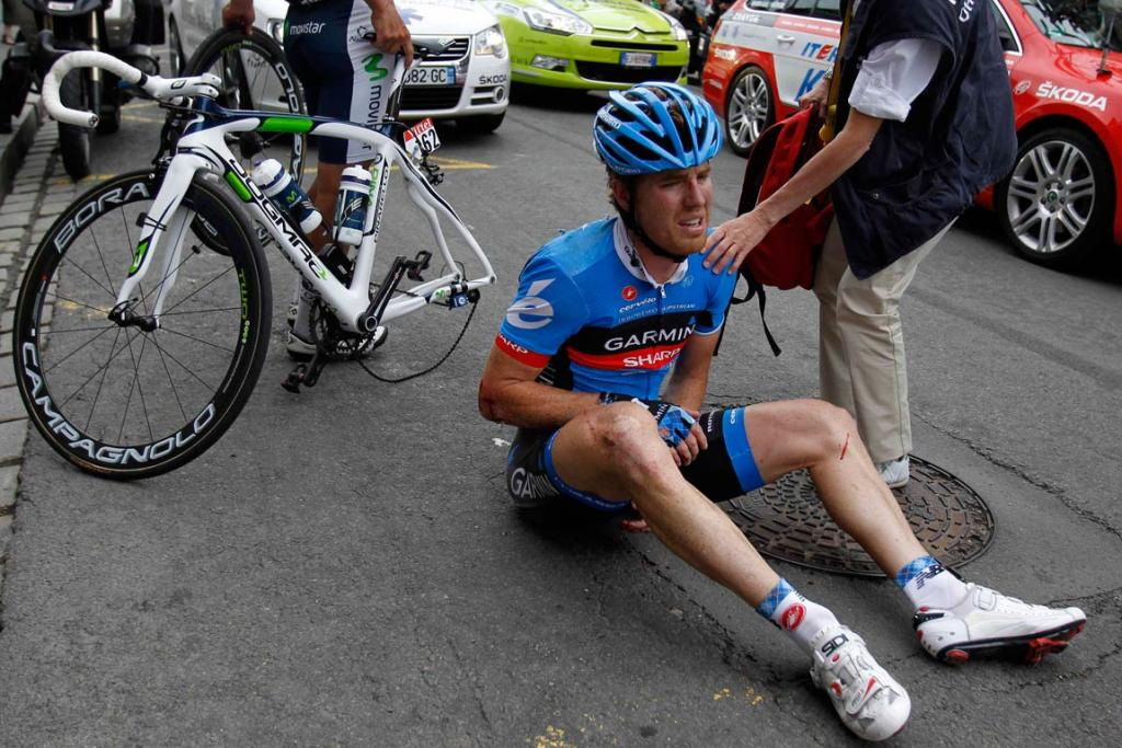 Garmin-Sharp rider Tyler Farrar receives treatment after a crash late in the stage.