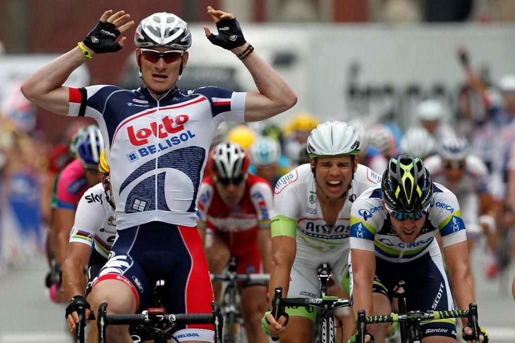 Lotto-Belisol rider Andre Greipel of Germany, teammate of New Zealand's Greg Henderson, celebrates the stage five victory.