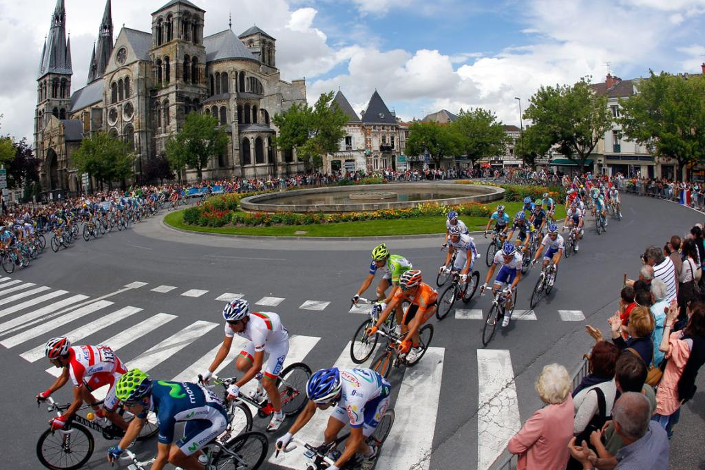 The peloton passes a cathedral during stage six from Epernay to Metz.