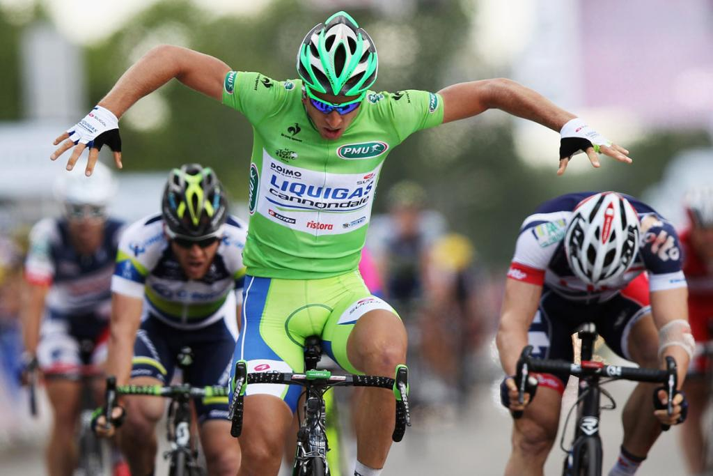 "Stage six winner Peter Sagan celebrates with ""the Hulk"" as he crosses the finish line."