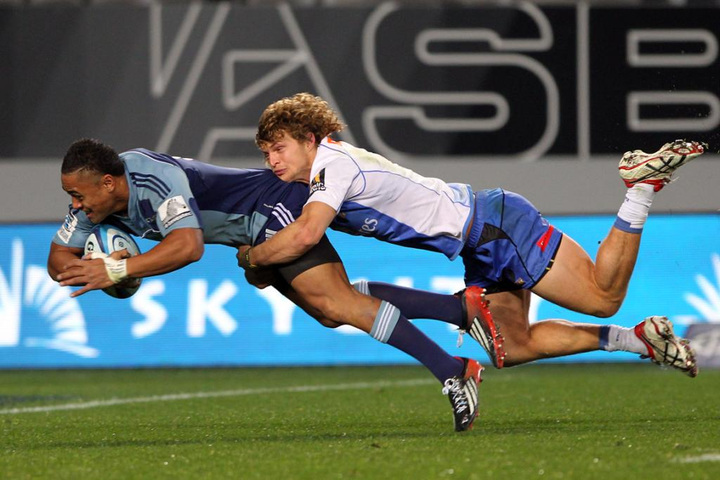 Francis Saili is tackled by the Force's Nick Cummins.