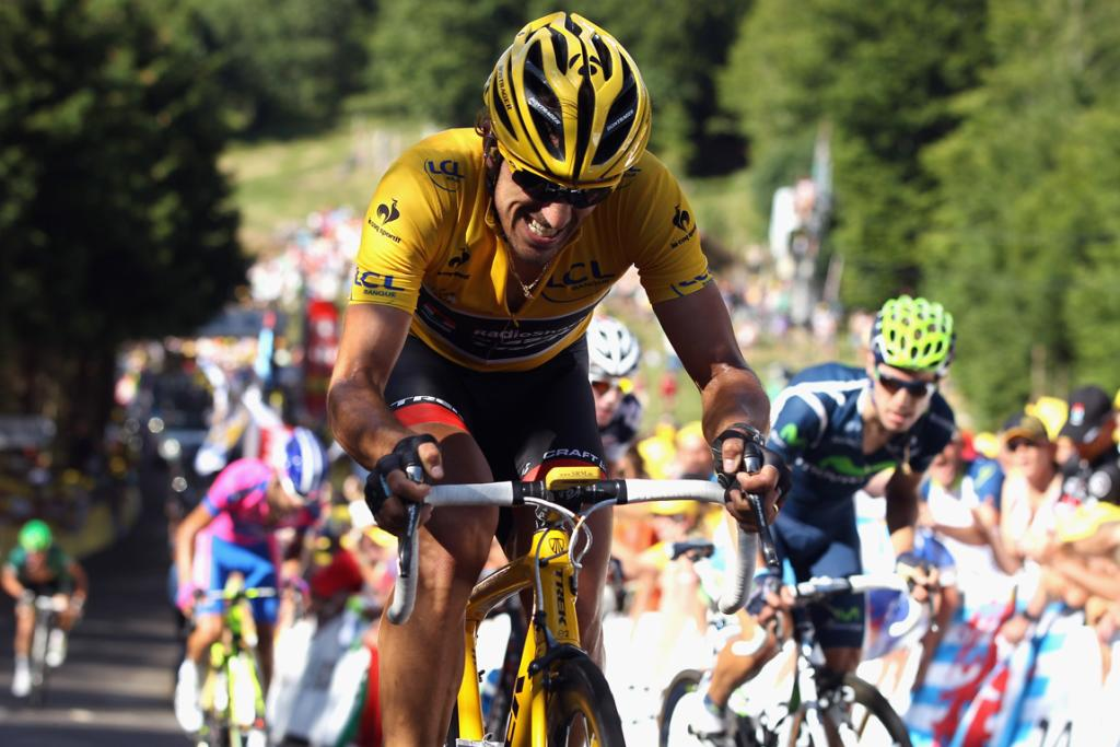 Fabian Cancellara, who relinquished the yellow jersey, struggle up a hill during stage seven.