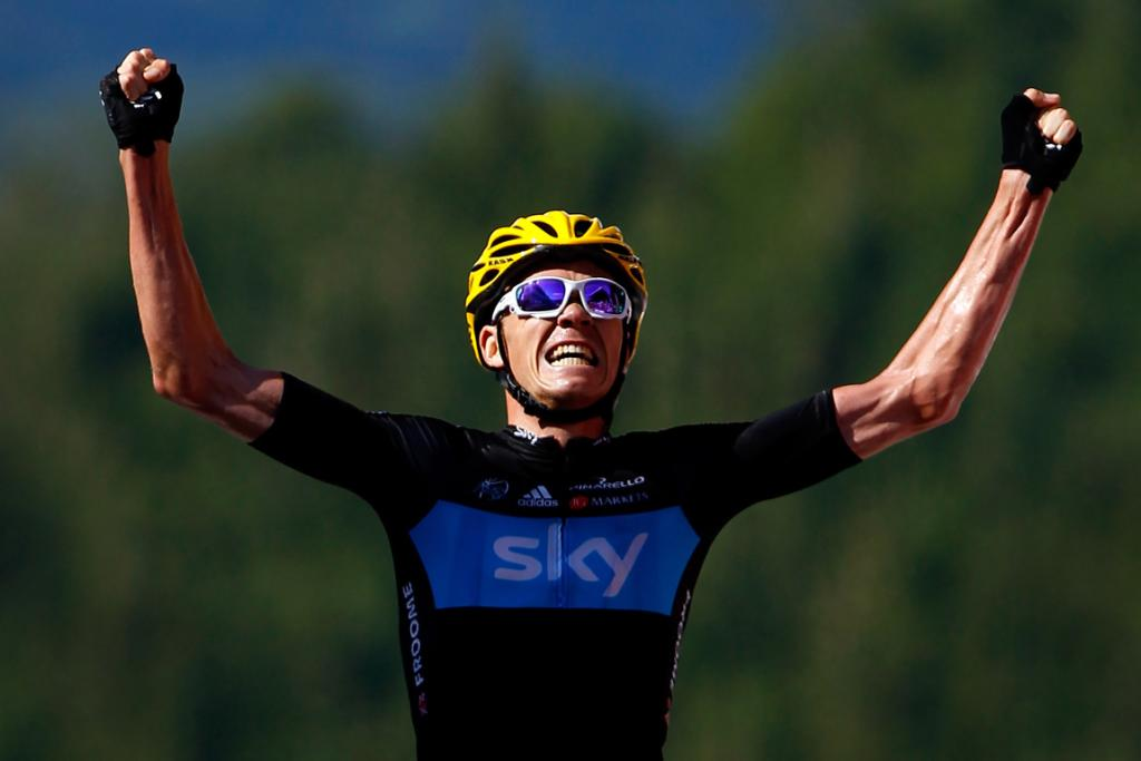 Christopher Froome of Great Britain celebrates as he crosses the finish line to win stage seven.