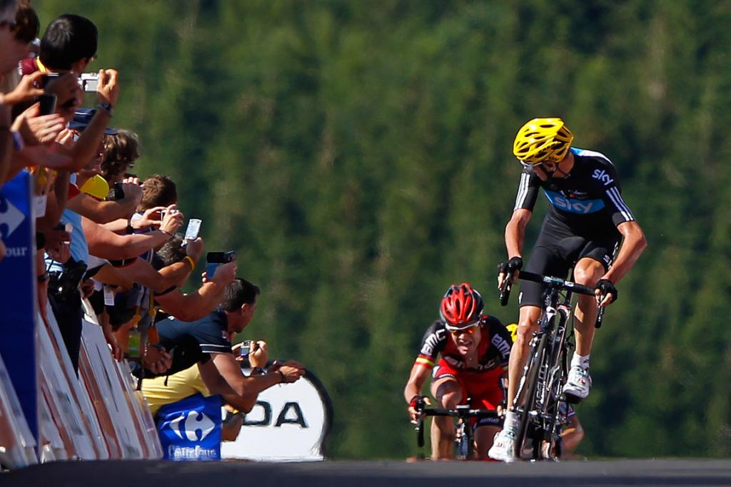 Christopher Froome takes a look back at Cadel Evans as the riders approach the finish of stage seven.