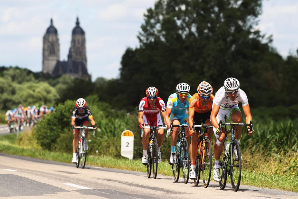 The peloton ride through the French Countryside during stage seven from Tomblaine to La Planche des Belles Filles.