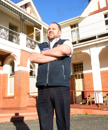 GOING: Salvation Army captain Doug Newman outside the earthquake-risk building in Leven St that residents and staff had planned to leave for new  accommodation. However, a lack of funding means the service may close completely.