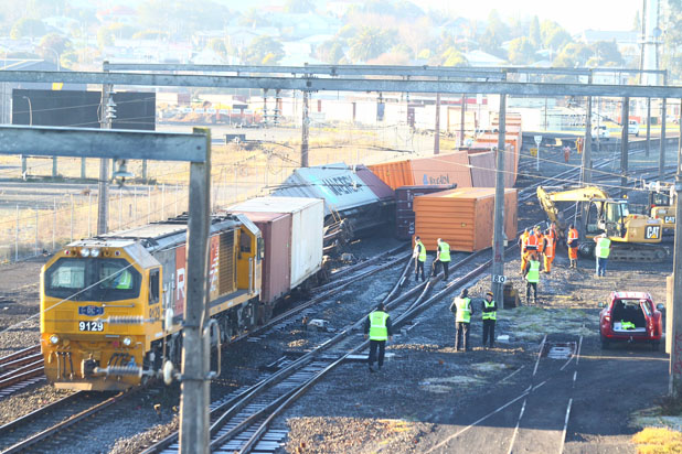 Two wagons tipped to their side in the Frankton rail yard after a freight train from Tauranga derailed this morning.