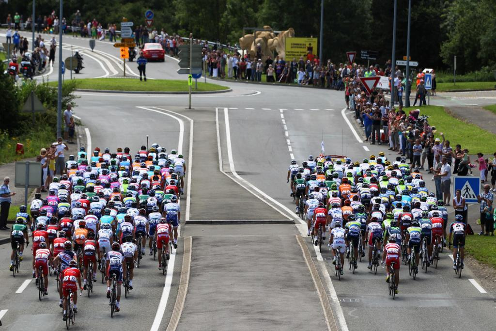 The peloton ride out of Belfort at the start of stage eight.