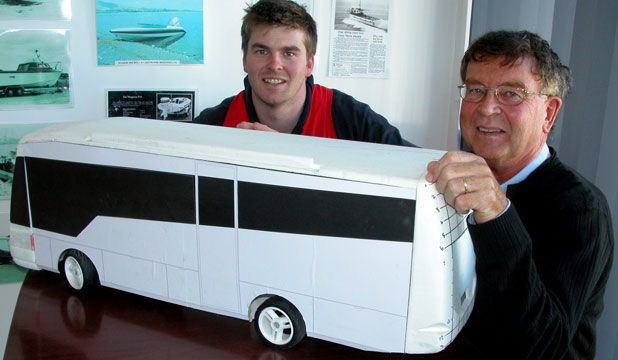 FAMILY DUO: Aeromarine Industries' Trevor Robb, right, and son Simon look at a prototype of a new body module for a bus.