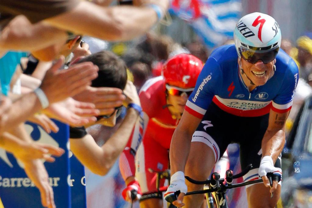 Frenchman Sylvain Chavanel is roared on by parochial supporters during the ninth stage time trial.