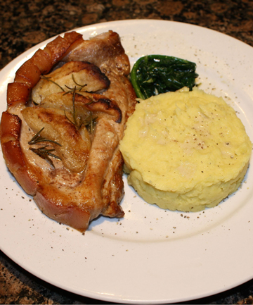Moreish main: Pork shoulder chops, kumara mash and blue cheese spinach are a real winner in Paula Brown's house.