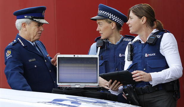 GET SMART: Police Commissioner Peter Marshall discusses the project to provide frontline police with devices such as smartphones, laptops and iPads with Constable Harriet Murray, centre, and Detective Constable Andrea Quinn, of Lower Hutt Police.