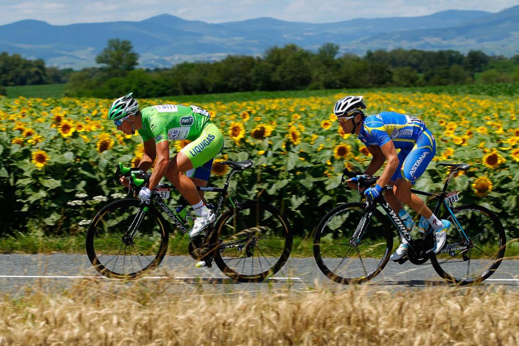 Peter Sagan and Andriy Grivko breakaway from the peloton early in stage ten from Macon to Bellegarde-Sur-Valserine.