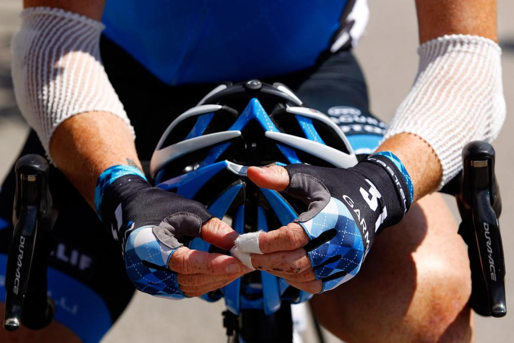 The bandaged hands and arms of Tyler Farrar of the USA as he prepares to start stage ten.