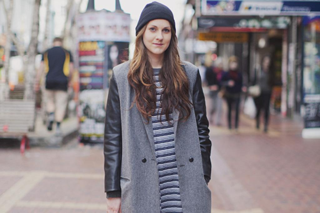 Fashion student Ayla, photographed on Cuba St, wearing a coat she designed and made herself with a vintage shirt.