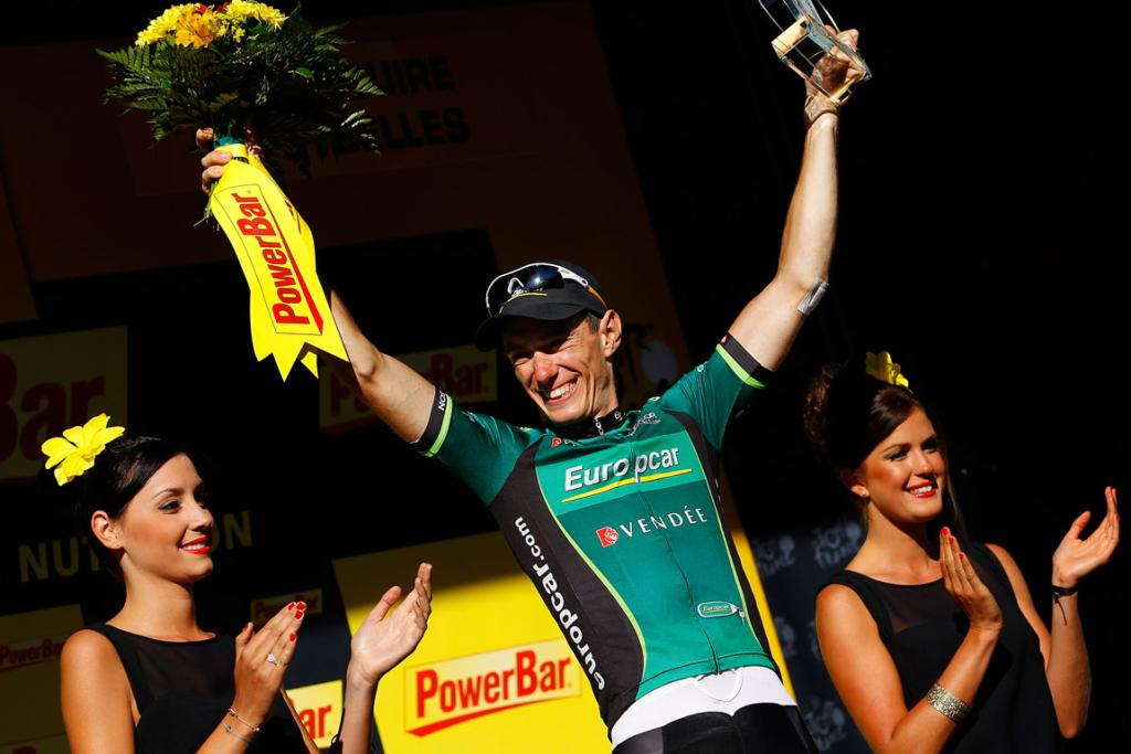French rider Pierre Rolland stands atop the podium after winning the 11th stage.