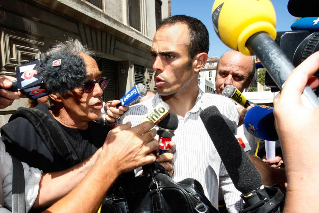 French rider Remy Di Gregorio faces the media outside a court in Marseille. He faces charges of being in possession of banned substances during the Tour de France.