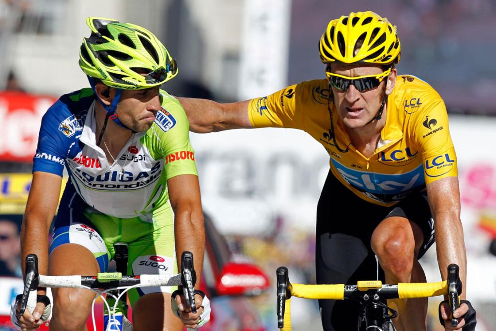 Tour de France leader Bradley Wiggins (R) and Italian rider Vincenzo Nibali exchange pleasantries near the end of the mountainous 11th stage.