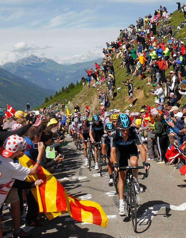 Fans in the Alps gather to cheer on riders on the 11th stage of the Tour de France.