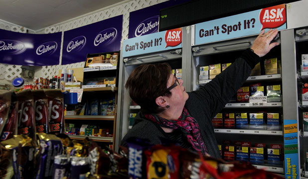 OUT OF SIGHT: Mountainview Dairy owner-operator Joy Hutson gets ready for the new rules banning the public display of tobacco and advertising.