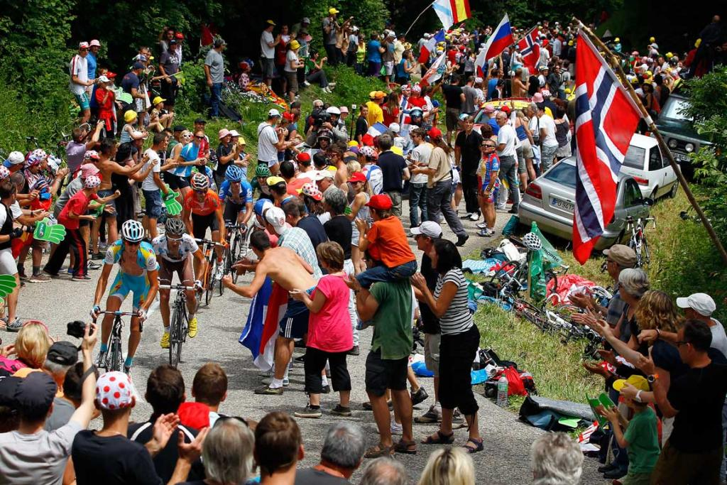 The lead group including stage winner David Millar of Great Britain make their way through the fans as they approach the summit of the Col du Granier in stage 12.