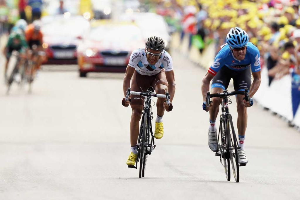 David Millar (right) of Great Britain out-sprints Jean-Christophe Peraud to win stage twelve of the 2012 Tour de France.