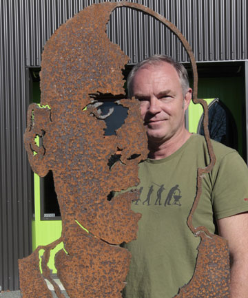 SEEING DAYLIGHT: Neville Parker with a piece of cut steel sculpture at The Icon Centre for Contemporary Art in Upper Moutere.