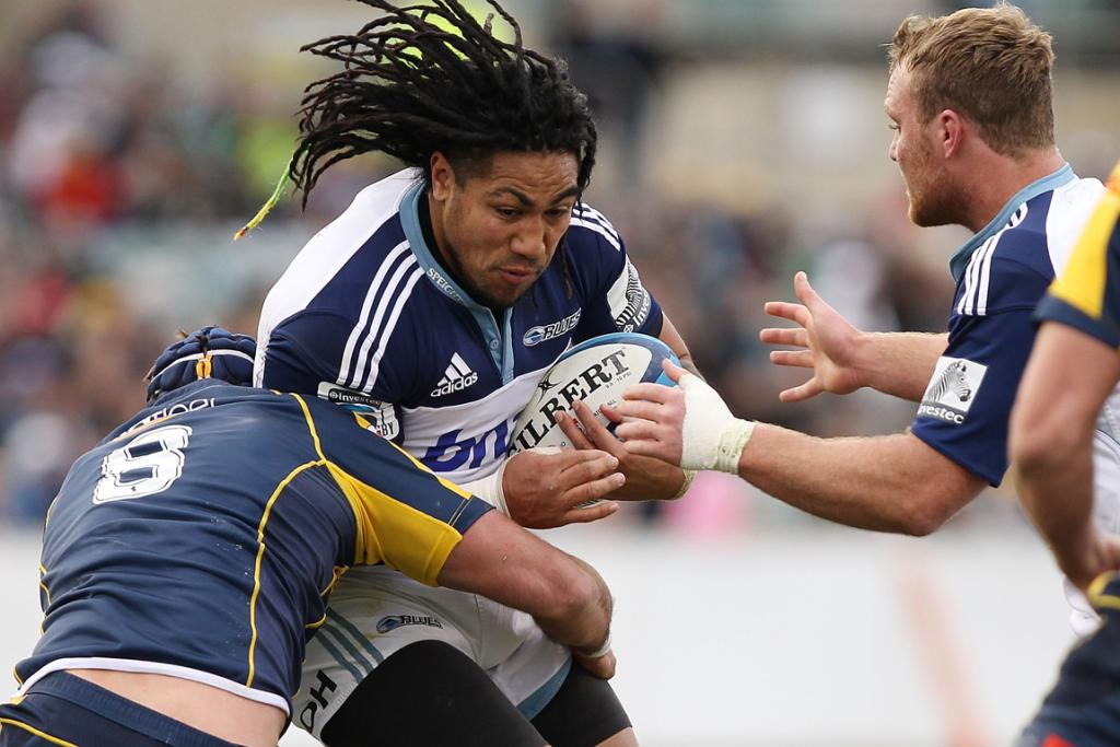 Ma'a Nonu of the Blues is tackled against the Brumbies at Canberra Stadium.