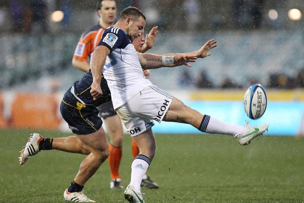Alby Mathewson of the Blues kicks the ball against the Brumbies at Canberra Stadium.