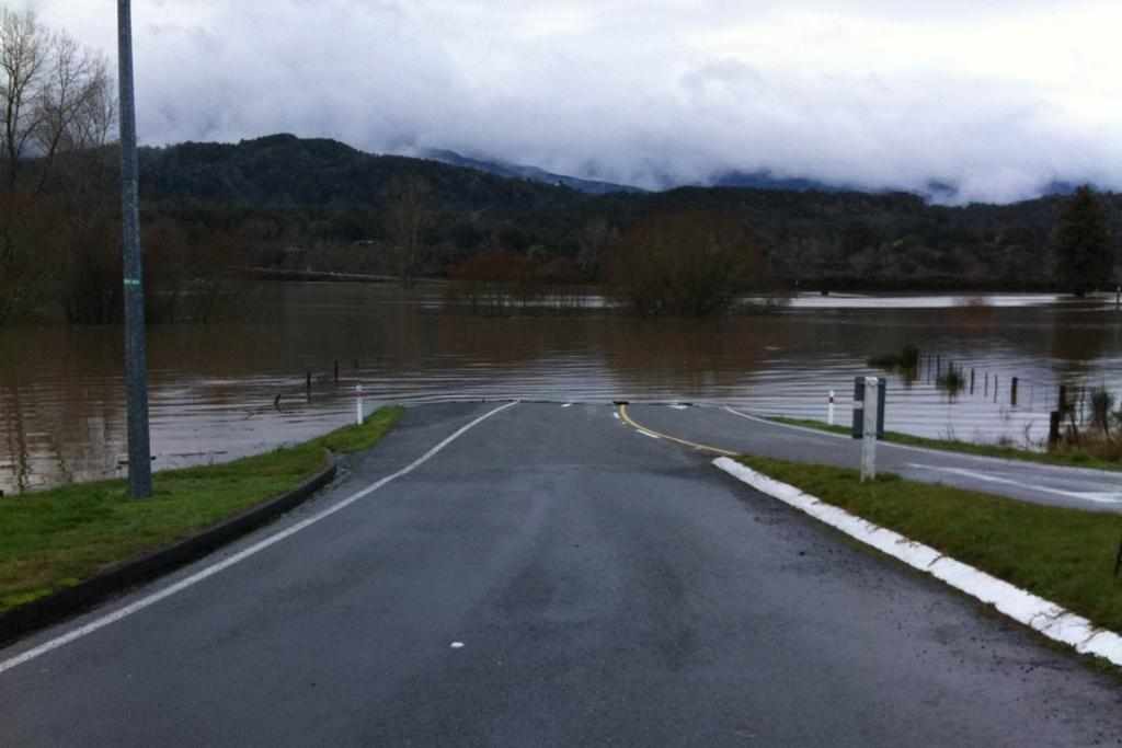 Buller River flooding at the Nelson-Westport turnoff at Inangahua Junction.