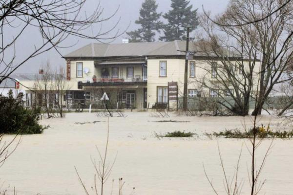 The Wakamarina River roars past the Historic Trout Hotel in Canvastown.