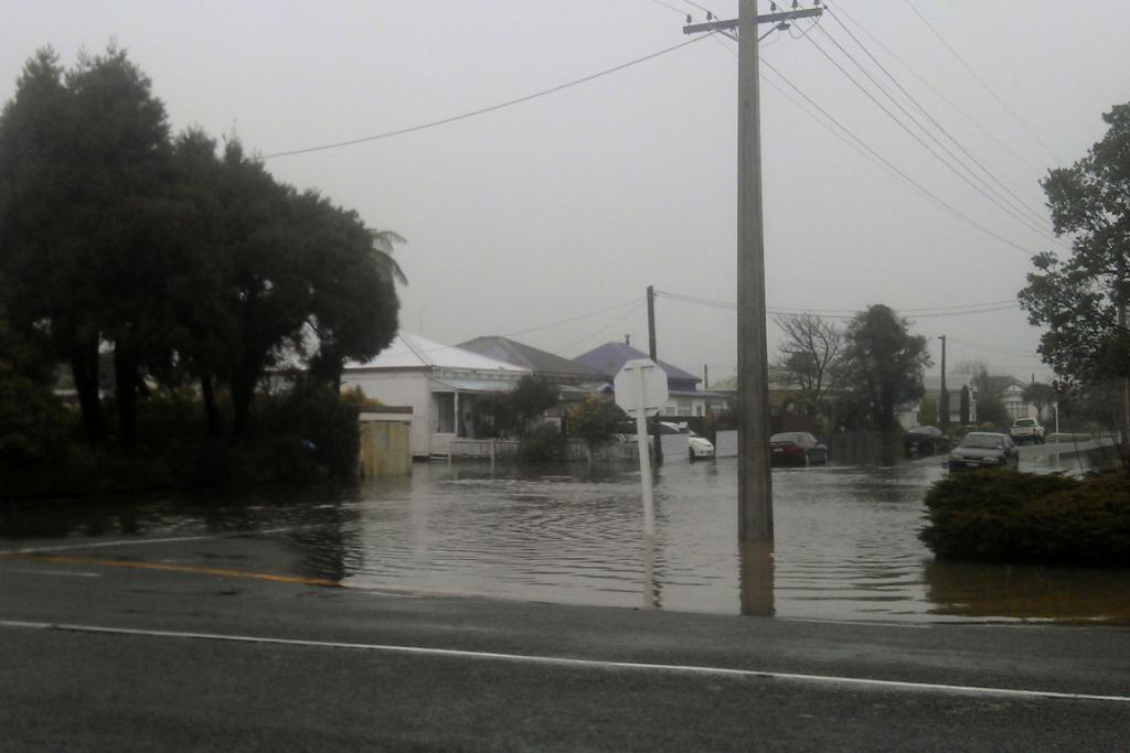 Surface flooding in Westport cause by a rain-swollen Buller River.