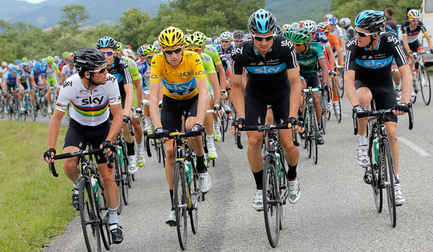 WAITING GAME: Members of the Sky Procycling team, including Tour de France leader Bradley Wiggins (2L), slow the pace of the peleton to allow riders caught up by punctures catch up during stage 14.