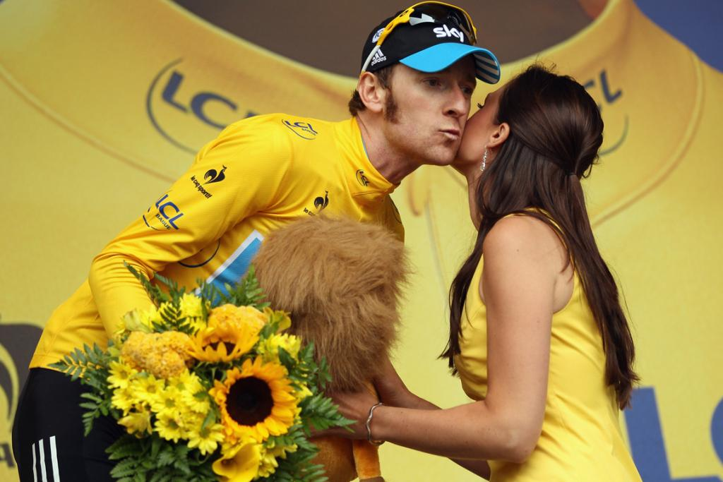 Race leader Bradley Wiggins of Great Britain retained his yellow jersey after stage fourteen of the Tour de France.