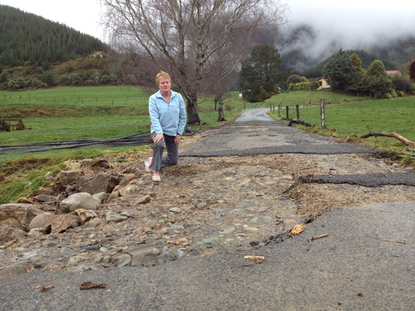 Canvastown farm owner Noeline Bryant assesses the flood damage to her driveway after the Pelorus River burst its banks on Sunday morning.