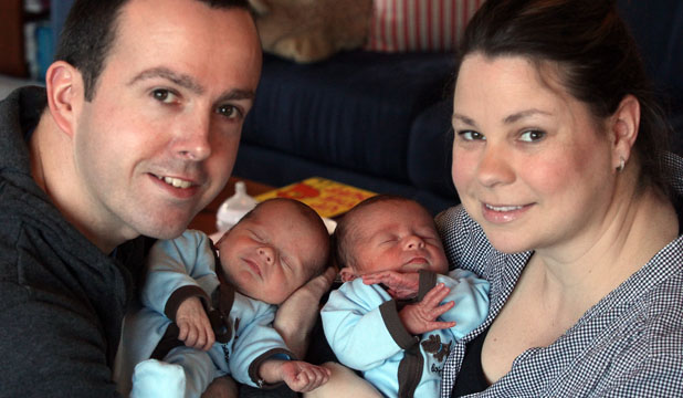 TWO LADS: Ian and Nicola Burton with twin boys Oliver, left, and Lucas, who were born on July 2.