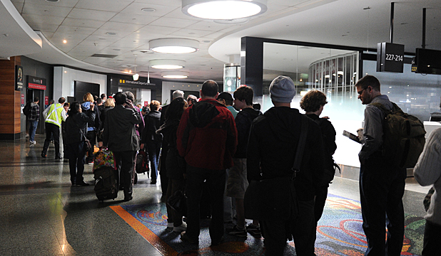 FRUSTRATIONS: Passengers queue through the airport after the power cut.