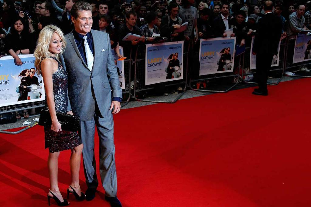 Cleans up nicely: David Hasselhoff and his girlfriend Hayley Roberts pose for photographers.
