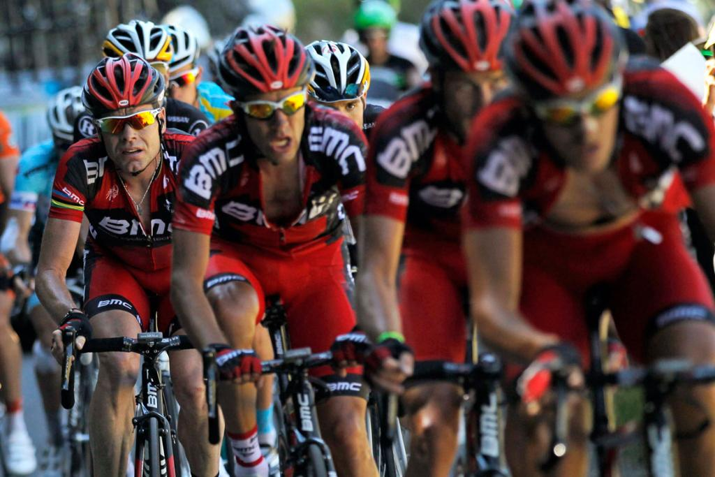 Australian defending champion Cadel Evans (far left) struggles on stage 16 despite the help of his BMC Racing Team.