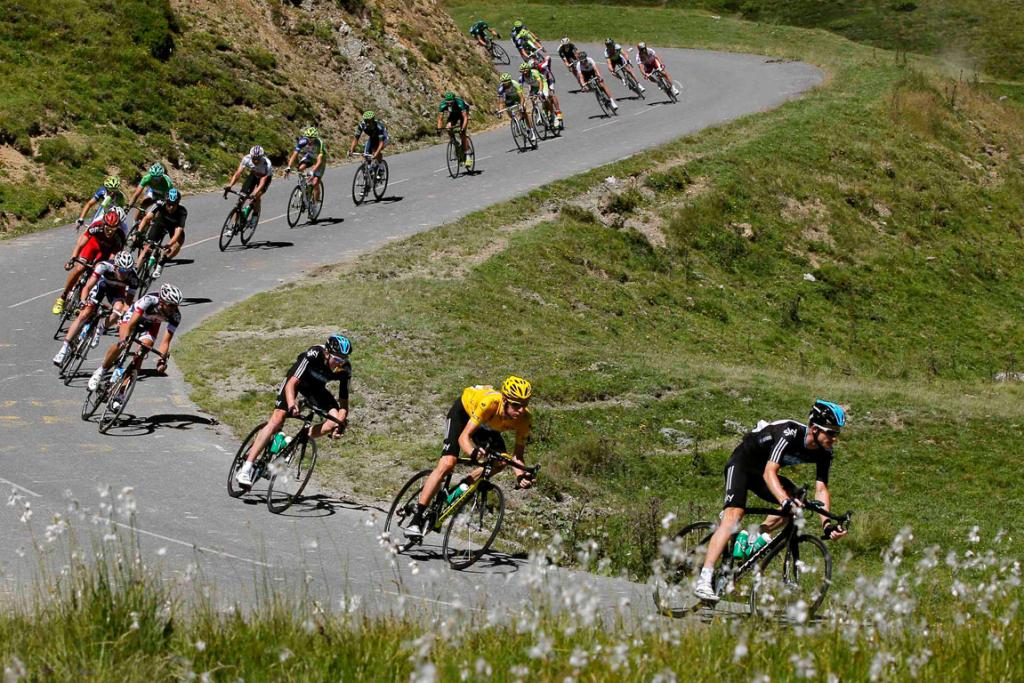 Riders, including Tour de France leader Bradley Wiggins (2R), descend the Pyrenees during the 16th stage.