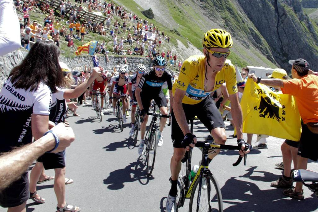 Tour leader Bradley Wiggins battles through the heat during stage 16.