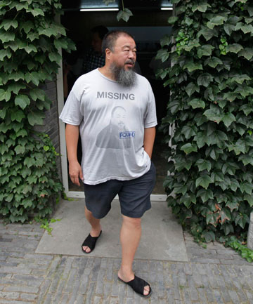 Dissident artist Ai Weiwei walks outside his home in Beijing, China.