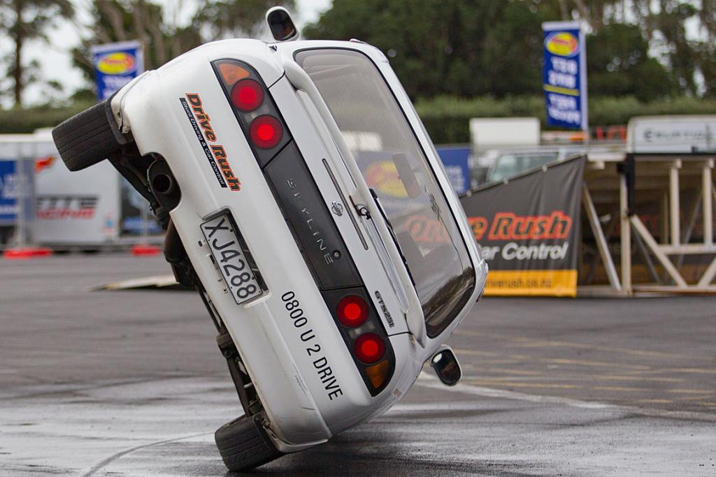 A stunt driver entertains.