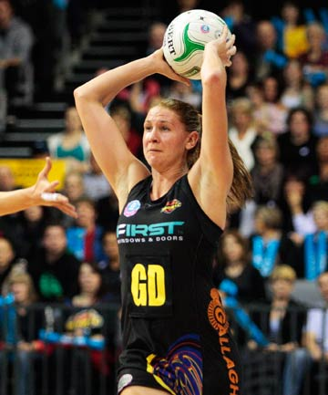 ON THE UP: Magic captain Casey Williams looks to move the ball upcourt after pulling in an intercept.