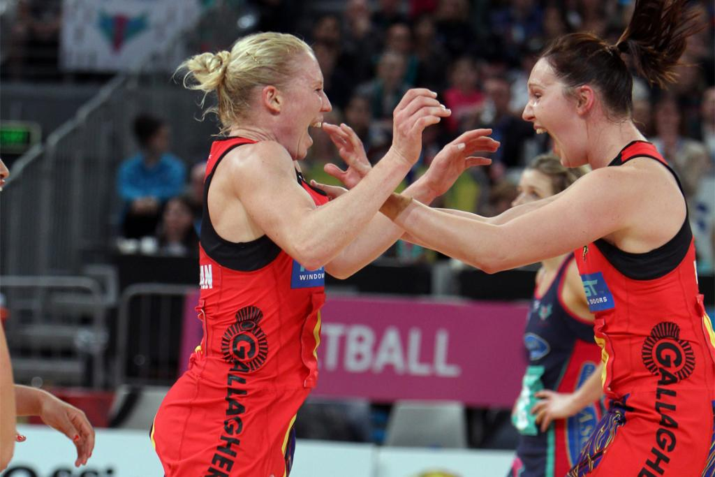 Laura Langman (left) and Khao Watts of the Magic react at the final whistle.