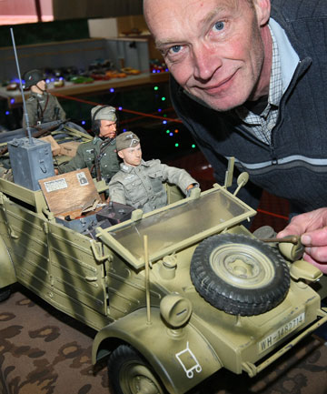 Model-maker Bob Hartsuiker with the scale models he made of a Kubel Wagon and German soldiers